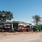 A collection of food trucks in a parking lot