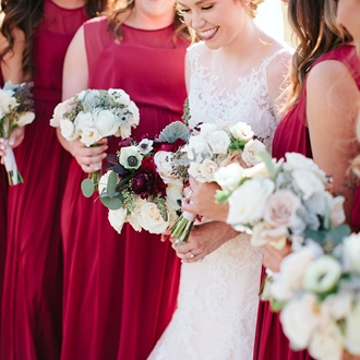A smiling bride and her brides maids
