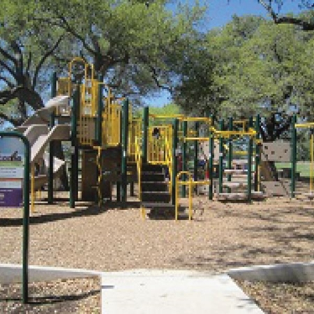 A playground located in a city park.