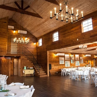 The inside of a wooden barn set up for a wedding site
