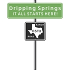A street sign that say Dripping Springs Texas - It All Starts Here