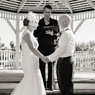 A blacka dn white image of a couple getting married.