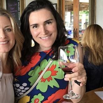Two women drinking wine.