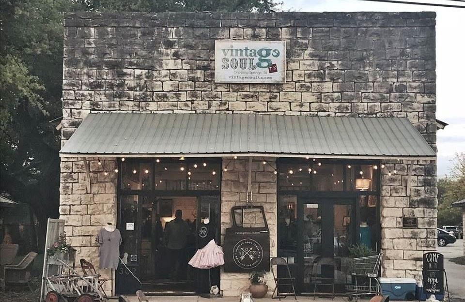 The front of an old stone building in downtown Dripping Springs