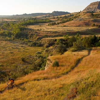 The Maah Daah Hey Trail near Medora, ND is a 97-mile non-motorized trail open for hiking, biking, and horseback riding. A short drive from Dickinson, ND.