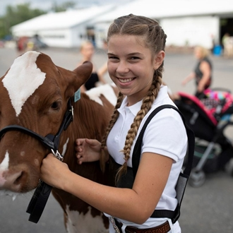 Photo of a girl and her dairy cow