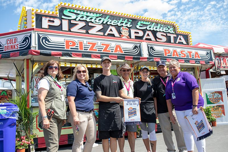 Staff and board giving out the best fare at the fair award