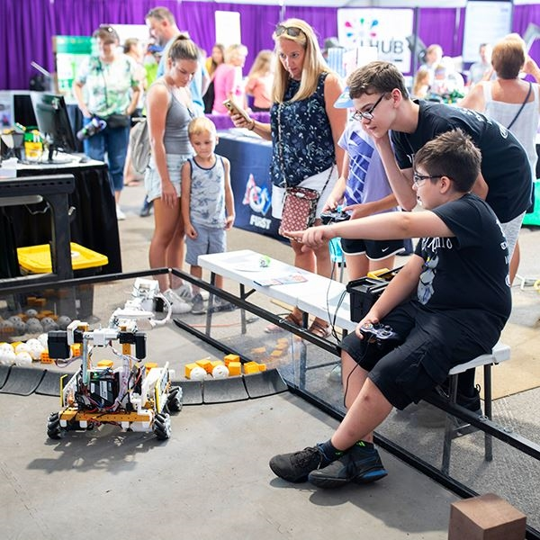Boys playing with robots