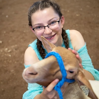 Photo of the Market Lamb show with a girl and her lamb