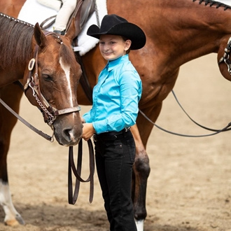 Photo of Child standing with their Horse