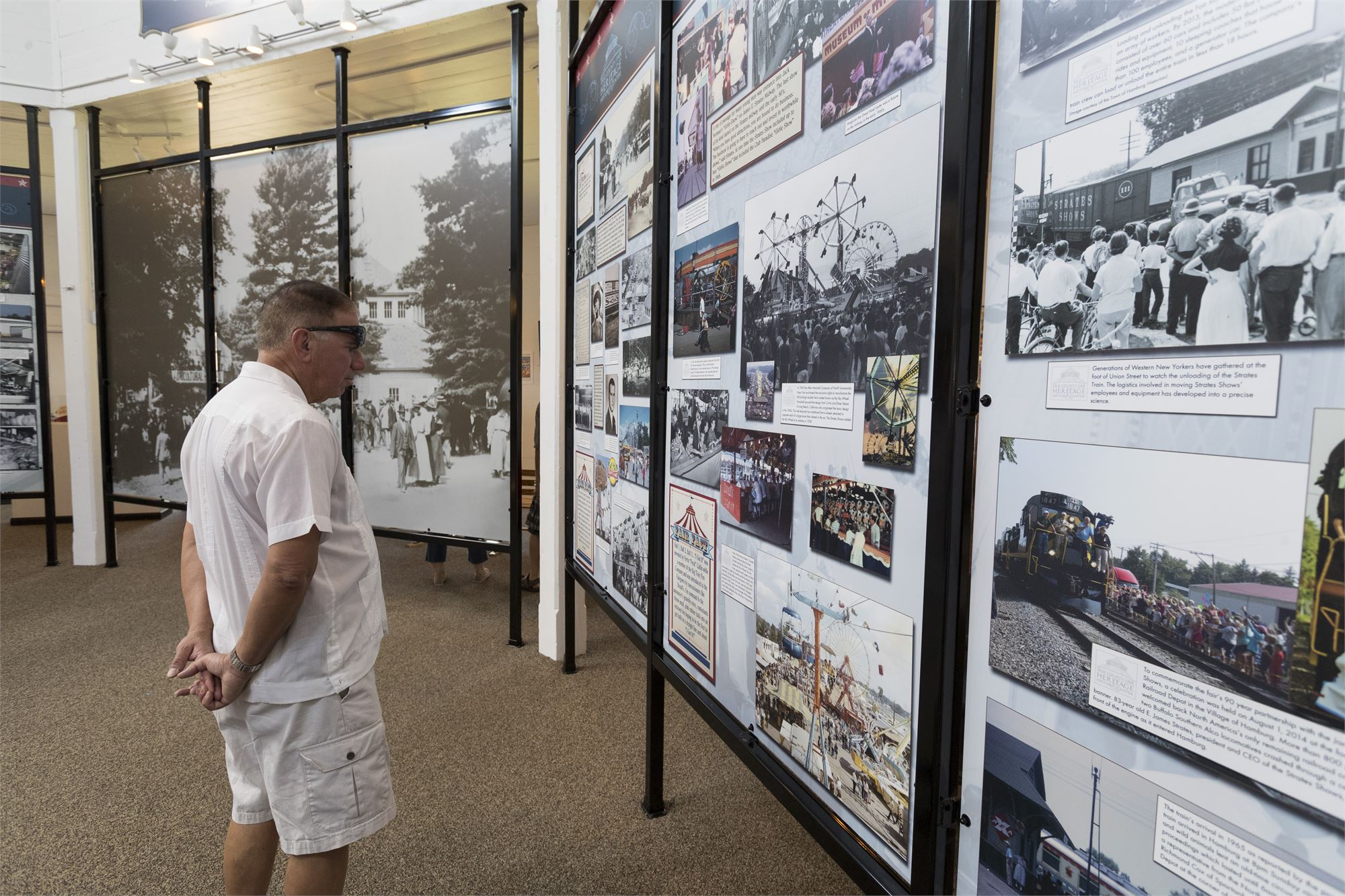 Photo of a Fairgoer looking at the informational panels inside the Heritage and History Center