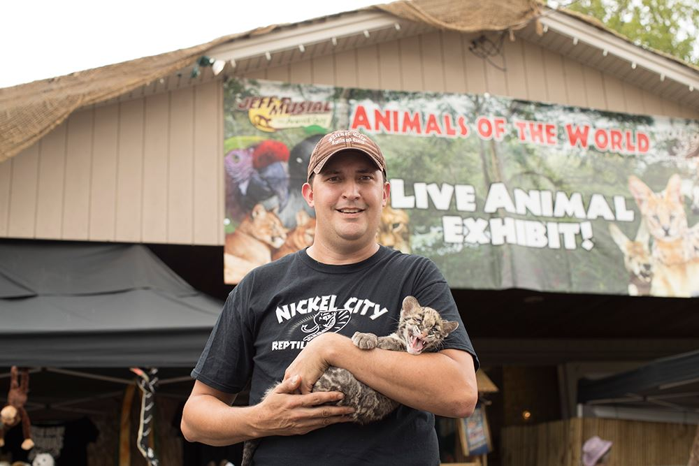 Photo of Jeff Musial holding an exotic cat