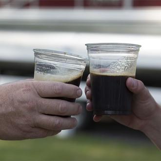 """Photo of people """"cheering"""" their beer"""