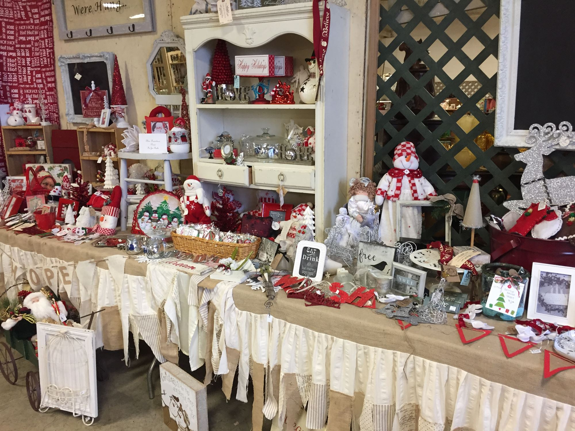 This is a photo that captures an example of a red and white-themed holiday display area at Every Husband's Nightmare Bazaar