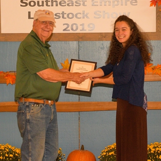 2019 Youth Exhibits Overall Winner Bethany Beauchamp with Gwinnett County Fair President Bill Atkinson
