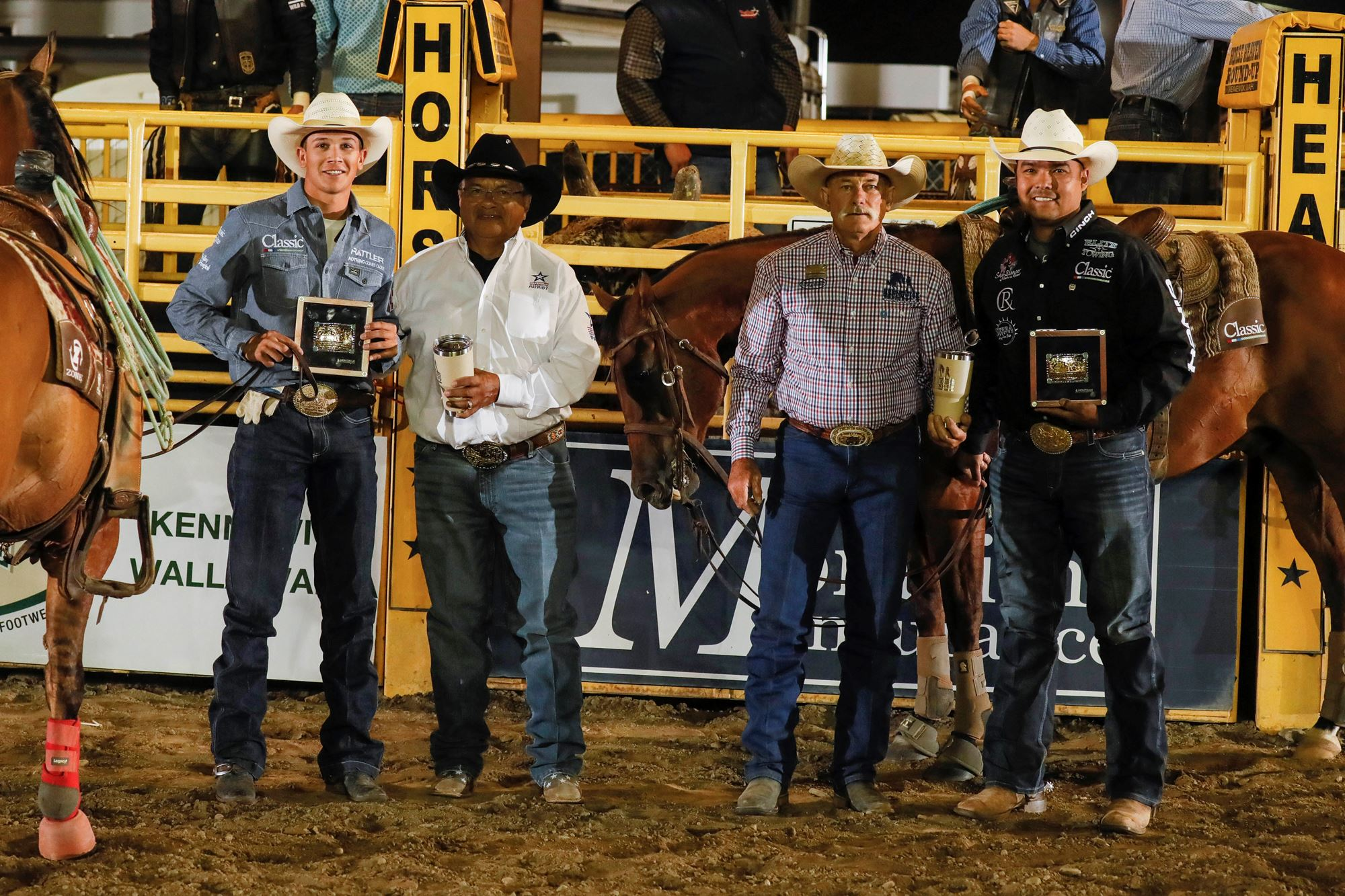 Erich Rogers and Paden Bray receiving awards for team roping