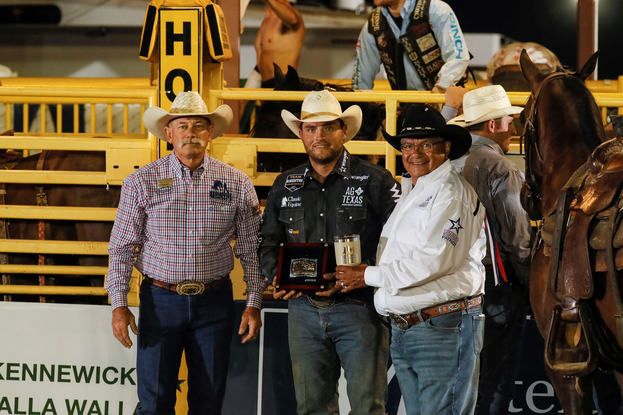 Jace Melvin receiving award for Steer Wrestling