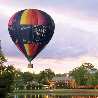 Exterior View of Boar's Head Resort with Hot Air Balloon Floating Above