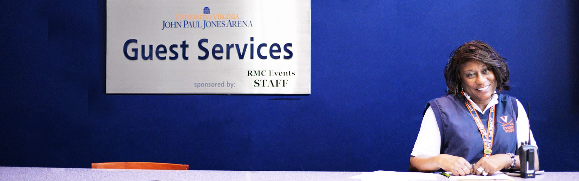 Guest Services Employee Smiling at JPJ Guest Services Desk
