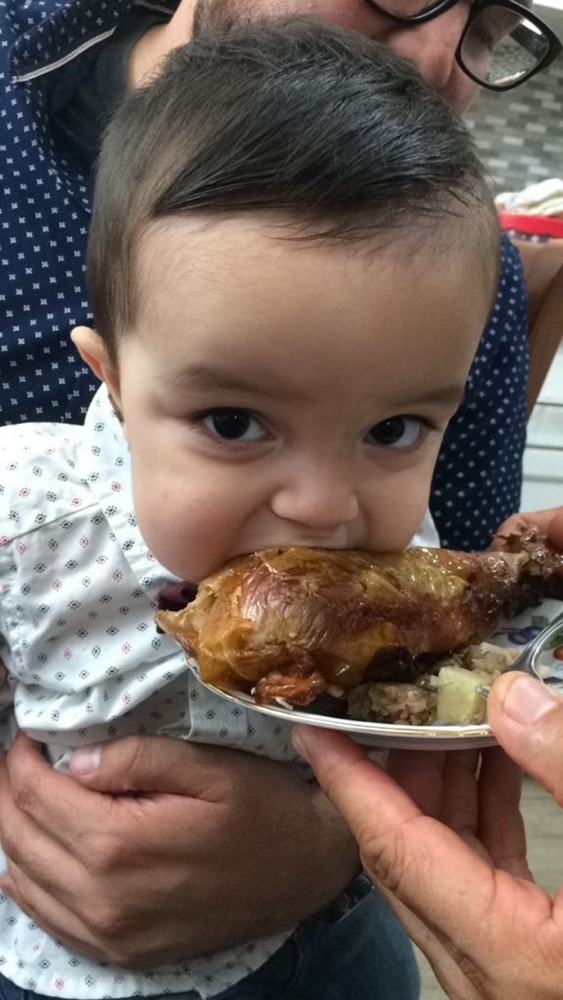My grandson Aiden eating a Turkey Leg!