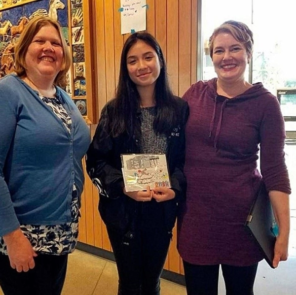 photo of Lynnwood Convention Center General Manager, Sara Blayne, along wiht winning student, Trang Nguyen, and Art Teacher, Amy Barnes.
