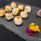 A delicious sushi spread across a black plate.