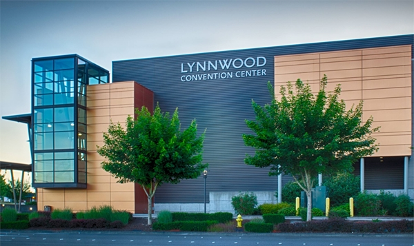 The Lynnwood Convention Center. Streetside view during the summer. Big green trees are in front of the building.