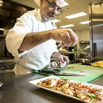 Chef Michael prepares a delicious food dish.
