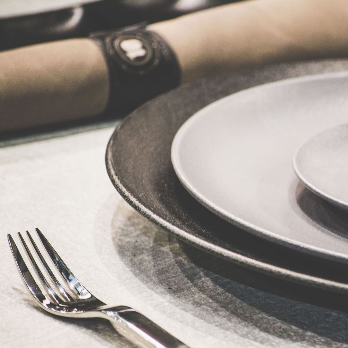 A closeup picture of three plates next to a fork.