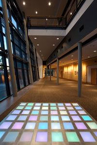 A large multi-colored floor. The floor is next to large, open windows. The hallway extends past the terra-pixel.