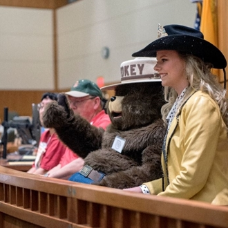 Deanne with Smokey Bear at the 2020 NM Legislative Session