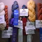 Close up of textiles with their winning ribbons
