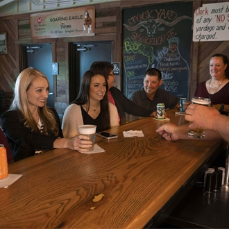 Friends enjoying a drink at the Stockyard Smokehouse Bar