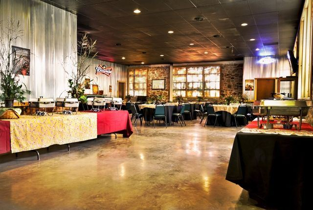 Boot Daddy Saloon with a buffet line set up and round tables with black linens set up