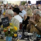 Close up of a table full of people bidding on the Livestock Auction