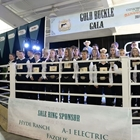 Youth livestock exhibitors pose for a photo in the show ring