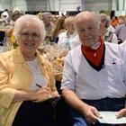 An elderly couple smiles for the camera