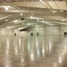 Empty 38,000 sqft east hall with white walls and ceilings.