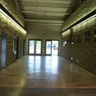 East Hall Corridor with rock walls and textured floors