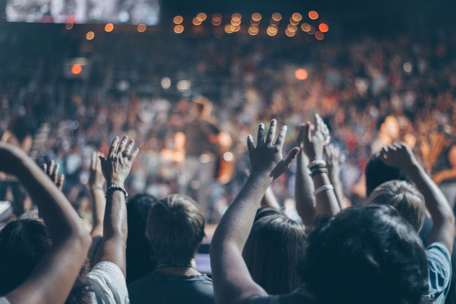 Crowd with hands lifted at a concert