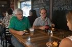 Friends enjoying a drink inside the Stockyard Smokehouse