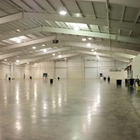 Empty 38,000 sqft west hall with white walls and ceilings.