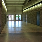 West Hall Corridor with rock walls and textured floors