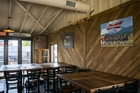 Focus on the wood wall that is made with wood from the old hay mangers at the Union Stockyards