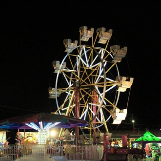 The evening comes alive with amusement ride fun at the McKean County Fair!