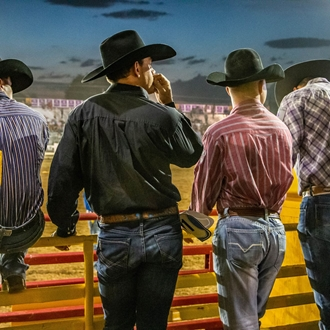 Contestants behind bucking chute