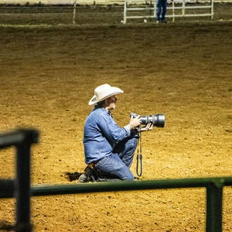 photographer taking photo in arena