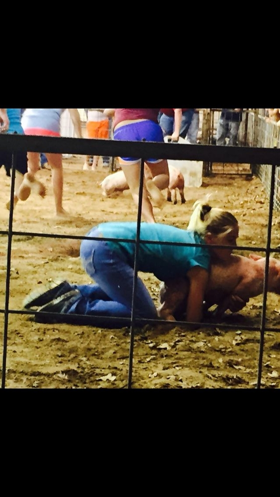 Jayme Condry member of Cameron Yoe FFA catching during the greased pig contest.