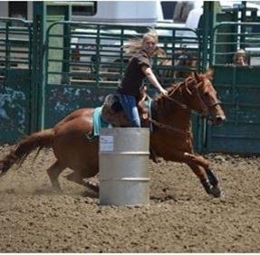 woman on horseback racing barrels