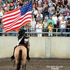 Miss Salinas Valley Fair holding American flag facing the crowd